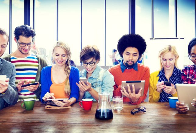 Line of people on different mobile devices