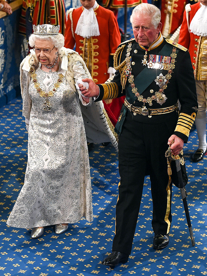 Her Majesty Queen Elizabeth II, accompanied by Prince Charles, walks through the Royal Gallery before delivering her speech at the State Opening of Parliament.State Opening of Parliament, London, UK - 14 Oct 2019