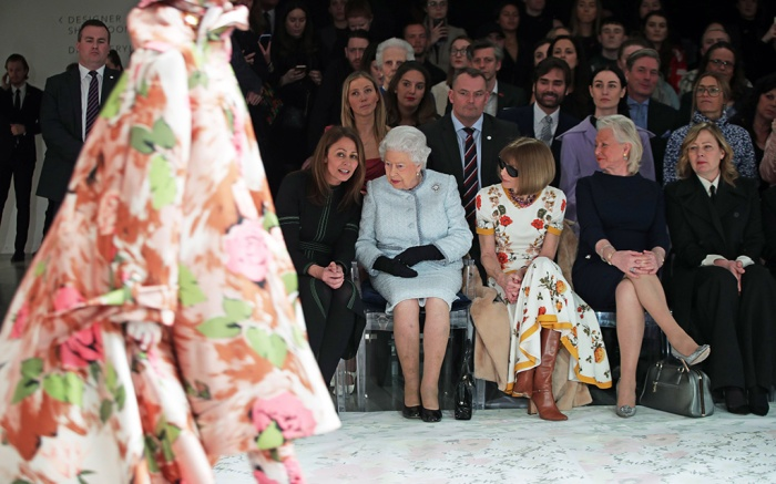 Queen Elizabeth II sits with Anna Wintour (third left), Caroline Rush (left), chief executive of the British Fashion Council (BFC) and royal dressmaker Angela Kelly (fourth left), as they view Richard Quinn's runway show before presenting him with the inaugural Queen Elizabeth II Award for British Design as she visits London Fashion Week's BFC Show Space in central London.Queen Elizabeth II attends London Fashion Week, UK - 20 Feb 2018