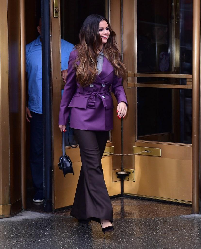 selena gomez, prada, purple jacket, coat, black pants, classic black pumps, stilettos, celebrity style, nyc, street style, Singer Selena Gomez wears a purple blazer leaving Z100 in New York City.Pictured: Selena GomezRef: SPL5125110 291019 NON-EXCLUSIVEPicture by: Robert O'Neil / SplashNews.comSplash News and PicturesLos Angeles: 310-821-2666New York: 212-619-2666London: +44 (0)20 7644 7656Berlin: +49 175 3764 166photodesk@splashnews.comWorld Rights
