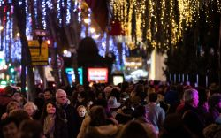 Passers-by, Christmas shoppers and tourists walk