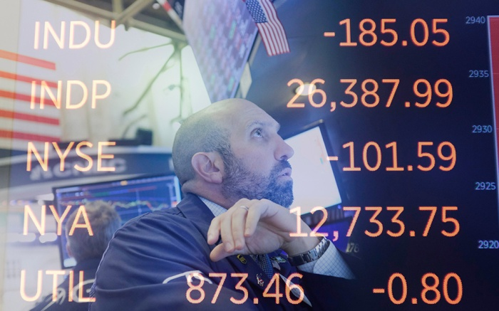 In an in-camera multiple exposure image, a trader is seen working on the floor at the New York Stock Exchange with a screen of numbers also seen showing the Dow Jones industrial average in New York, New York, USA, on 02 October 2019. The Dow Jones industrial average was down over 300 points in early trading.New York Stock Exchange, USA - 02 Oct 2019