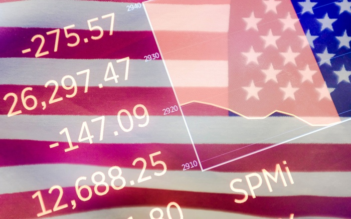 In an in-camera multiple exposure image, an America flag is seen working on the floor at the New York Stock Exchange with a screen of numbers also seen showing the Dow Jones industrial average in New York, New York, USA, on 02 October 2019. The Dow Jones industrial average was down over 300 points in early trading.New York Stock Exchange, USA - 02 Oct 2019
