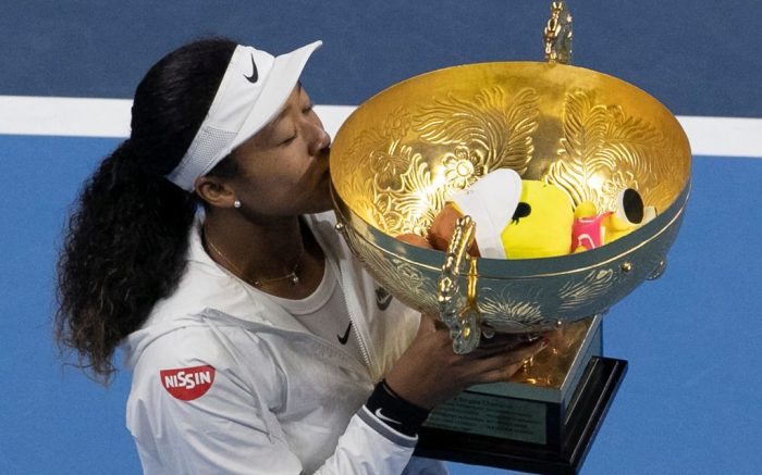 Naomi Osaka of Japan kisses her winner's trophy after defeating Ashleigh Barty of Australia in the women's final at the China Open tennis tournament in BeijingOpen Tennis, Beijing, China - 06 Oct 2019
