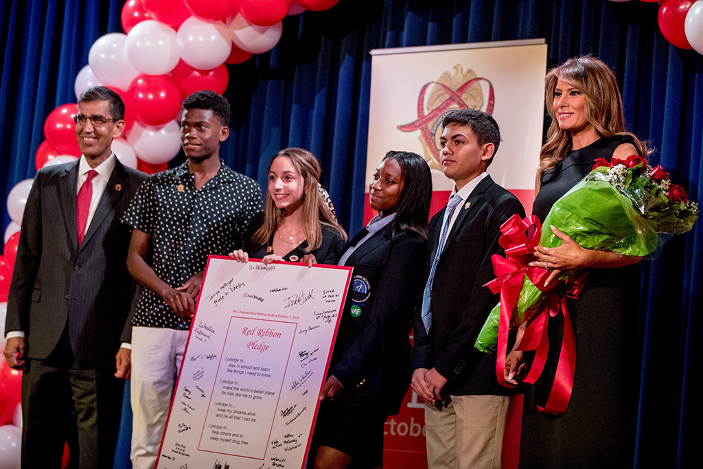 Melania Trump, Uttam Dhillon. First lady Melania Trump, right, and acting DEA Administrator Uttam Dhillon, left, pose with students at a Red Ribbon Rally at the Drug Enforcement Agency in Arlington, VaMelania Trump, Arlington, USA - 07 Oct 2019