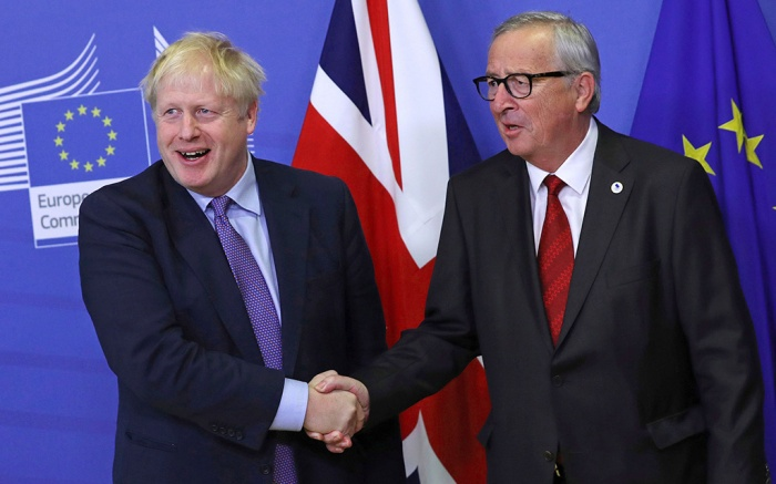 British Prime Minister Boris Johnson shakes hands with European Commission President Jean-Claude Juncker during a press point at EU headquarters in Brussels, . Britain and the European Union reached a new tentative Brexit deal on Thursday, hoping to finally escape the acrimony, divisions and frustration of their three-year divorce battleEU Brexit, Brussels, Belgium - 17 Oct 2019
