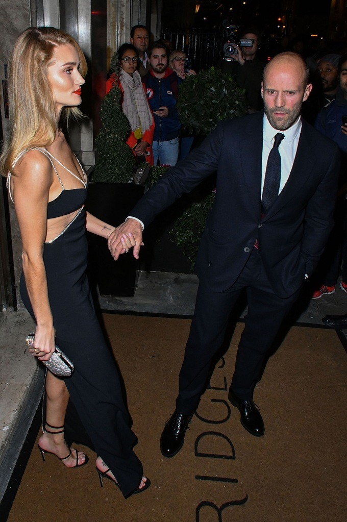 Rosie Huntington-Whiteley, david koma dress, legs, sandals, celebrity style, strappy sandals, cut-outs, abs, arms, blond hair, jason statham, celebrity couple, and Jason StathamHarper's Bazaar Women of the Year Awards, Claridge's, London, UK - 29 Oct 2019Rosie Huntington-Whiteley and Jason Statham attend Harper's Bazaar annual Women of the Year Awards, which celebrates female high-fliers, at Claridge's