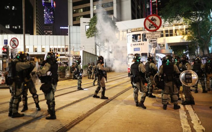 Riot police move amid tear gas to disperse protesters during a Halloween rally in Lan Kwai Fong, a bar district in Central in Hong Kong, China, 31 October 2019. Hong Kong has entered a fifth month of ongoing mass protests, originally triggered by a now withdrawn extradition bill to mainland China that have turned into a wider pro-democracy movement.Protesters celebrate Halloween in Hong Kong., China - 31 Oct 2019
