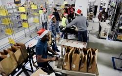 Amazon Prime employees push carts with
