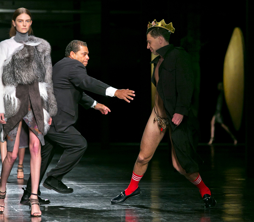 A streaker in a G-string, who interrupted the Prabal Gurung Fall 2014 collection as it is modeled, is chased by security, during Fashion Week, in New YorkNY Fashion Week Prabal Gurung, New York, USA