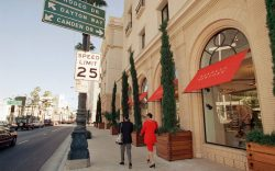 Pedestrians pass by the Barneys store