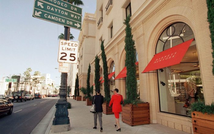 Pedestrians pass by the Barneys store in Beverly Hills, 1996, Barneys history.