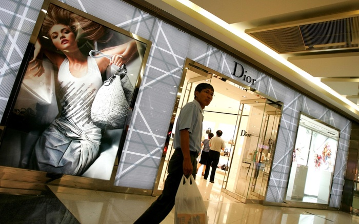 A man walks past a Dior store in Beijing . After generations of poverty many Chinese can now afford to buy luxury goods, providing a new market for many of the world's major luxury brandsChina The China Challenge, Beijing, China