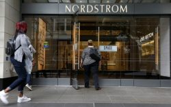 Shoppers enter Nordstrom's flagship store in
