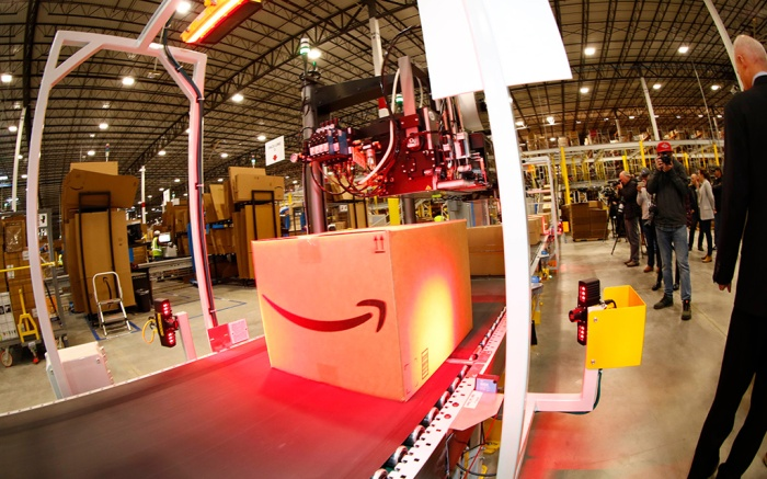 Amazon fulfillment center in Aurora, Colo. Boxes move along a conveyor belt for an address label during a tour of the Amazon fulfillment center, in Aurora, Colo. More than 1,000 full-time associates work in the Aurora facility, which opened in September 2017, and is one of more than 100 such fulfillment centers scattered across North AmericaAmazon Colorado - 03 May 2018