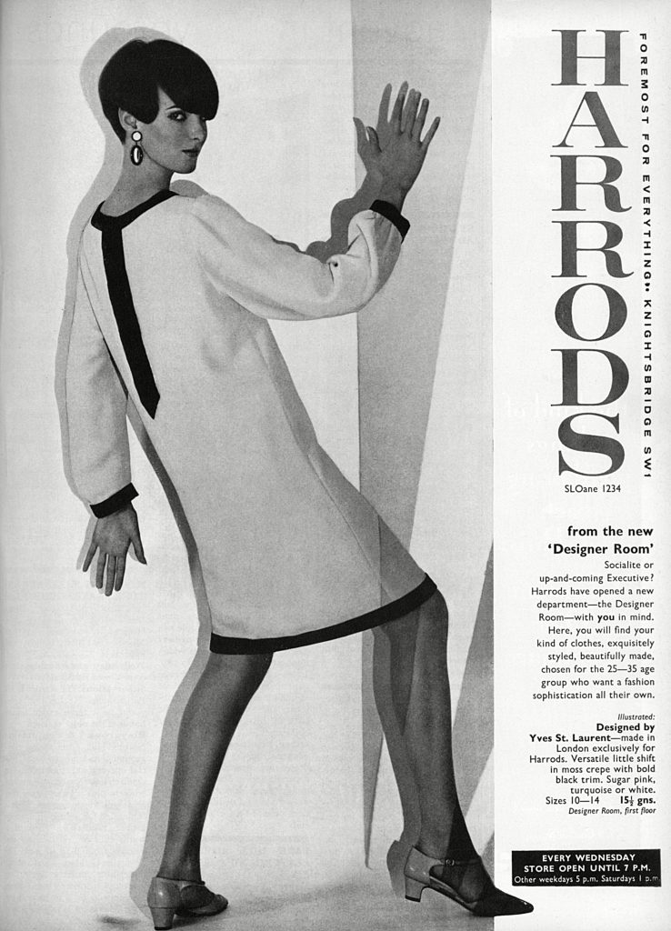 Advertisement For London Department Store Harrods Featuring A Knee Length Long-sleeved Shift Dress Designed by Yves St Laurent But Made in London Exclusively For Harrods (an Example of Couture Designers Licensing Their Designs For More Affordable Lines in Department Stores). the Dress Was Just One Example Harrods Were Offering in Their New Designer Department. . Unattributed Photograph, Published in London Life Magazine - October-december 1965 VolumeHarrods Advertisement Yves St Laurent Dress, 1965