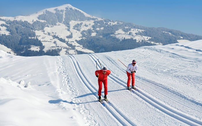 cross-country skiers on the Penningberg with a view of the Hohe Salve, Hopfgarten, Kitzbuehel Alps, Tyrol, AustriaVARIOUS