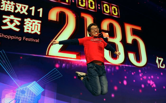 A staff member jumps for a photo to celebrate after Alibaba's 11.11 Global Shopping Festival also known as Singles Day sets a new record of RMB213.5 billion or more than US$30 billion in Shanghai, China, . Online shoppers in China have shattered last year's record of $24 billion in sales on the country's annual buying frenzy Sunday, as the tradition marked its 10th yearSingles Day, Shanghai, China - 12 Nov 2018
