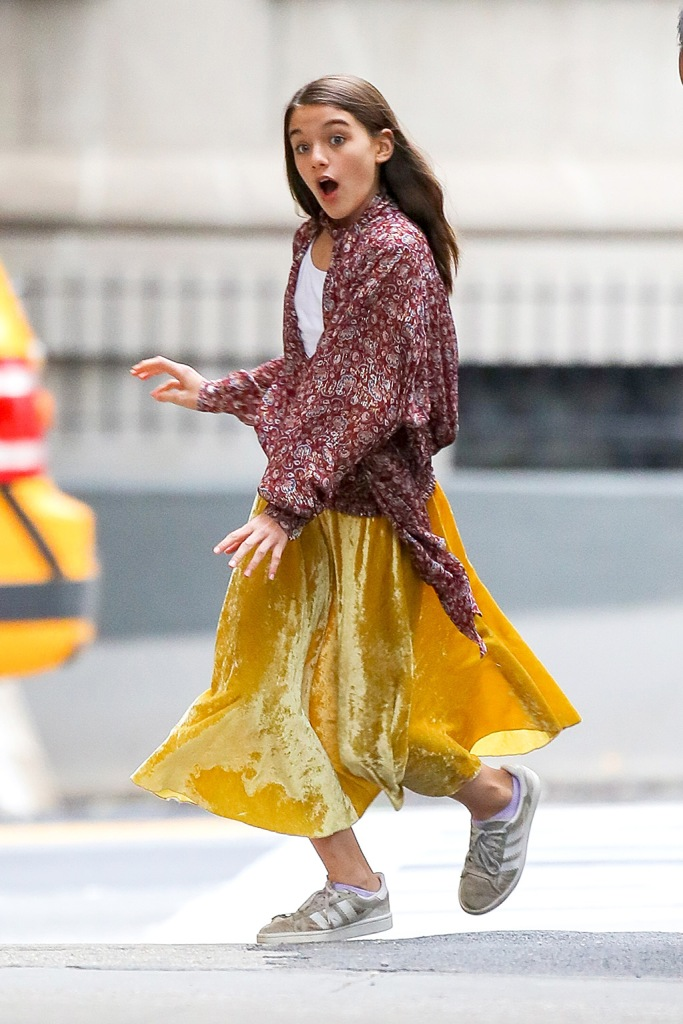Suri Cruise, yellow midi skirt, Adidas gazelle sneakers, boho style, Burgundy top, street style, celebrity style, fashion, was spotted all playful while out and about with a friend on Monday afternoon in NYCPictured: Suri CruiseRef: SPL5119695 300919 NON-EXCLUSIVEPicture by: Felipe Ramales / SplashNews.comSplash News and PicturesLos Angeles: 310-821-2666New York: 212-619-2666London: +44 (0)20 7644 7656Berlin: +49 175 3764 166photodesk@splashnews.comWorld Rights