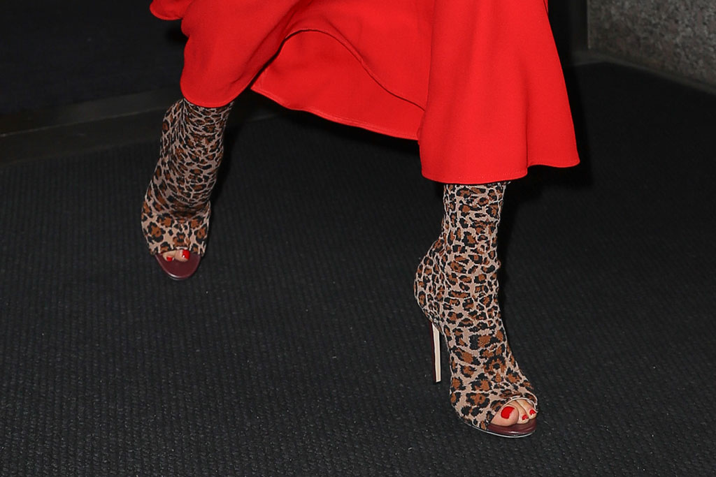 Victoria Beckham, leopard-print boots, stilettos, peep-toe boots, shoe style, pedicure, red nail polish, toes,