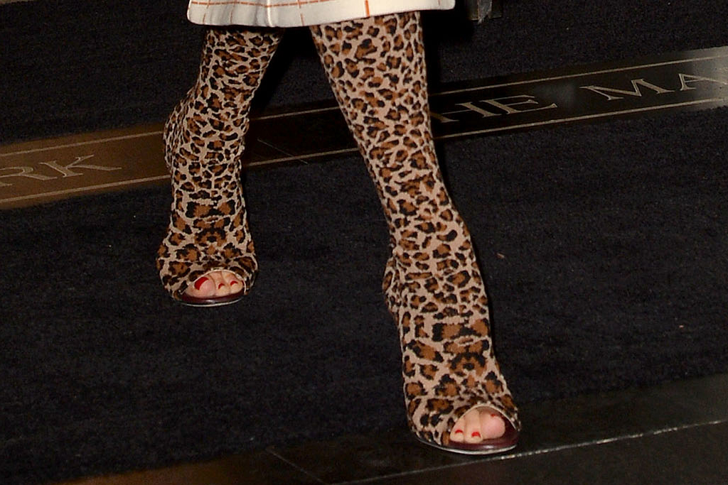 victoria beckham, leopard print boots, checkered suit, skirt, red top, new york, hotel, feet, pedicure