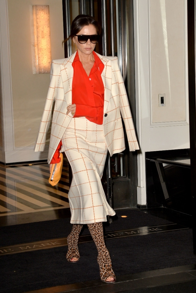 victoria beckham, leopard print boots, checkered suit, skirt, red top, new york, hotel