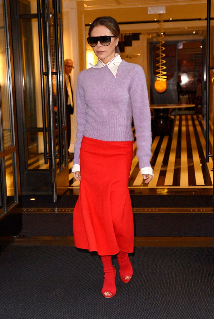 Victoria beckham, red midi skirt, purple sweater, collared shirt, updo, Celine sunglasses, shades, peep-toe boots, Victoria beckham fall 20119, celebrity style, British singer and fashion designer Victoria Beckham heading to business meetings in NYC.Pictured: Victoria BeckhamRef: SPL5122350 151019 NON-EXCLUSIVEPicture by: SplashNews.comSplash News and PicturesLos Angeles: 310-821-2666New York: 212-619-2666London: +44 (0)20 7644 7656Berlin: +49 175 3764 166photodesk@splashnews.comWorld RightsVictoria Beckham wears a red skirt and red shoes on her way to the Today show in New York CityPictured: Victoria BeckhamRef: SPL5122321 151019 NON-EXCLUSIVEPicture by: Edward Opi / SplashNews.comSplash News and PicturesLos Angeles: 310-821-2666New York: 212-619-2666London: +44 (0)20 7644 7656Berlin: +49 175 3764 166photodesk@splashnews.comWorld Rights