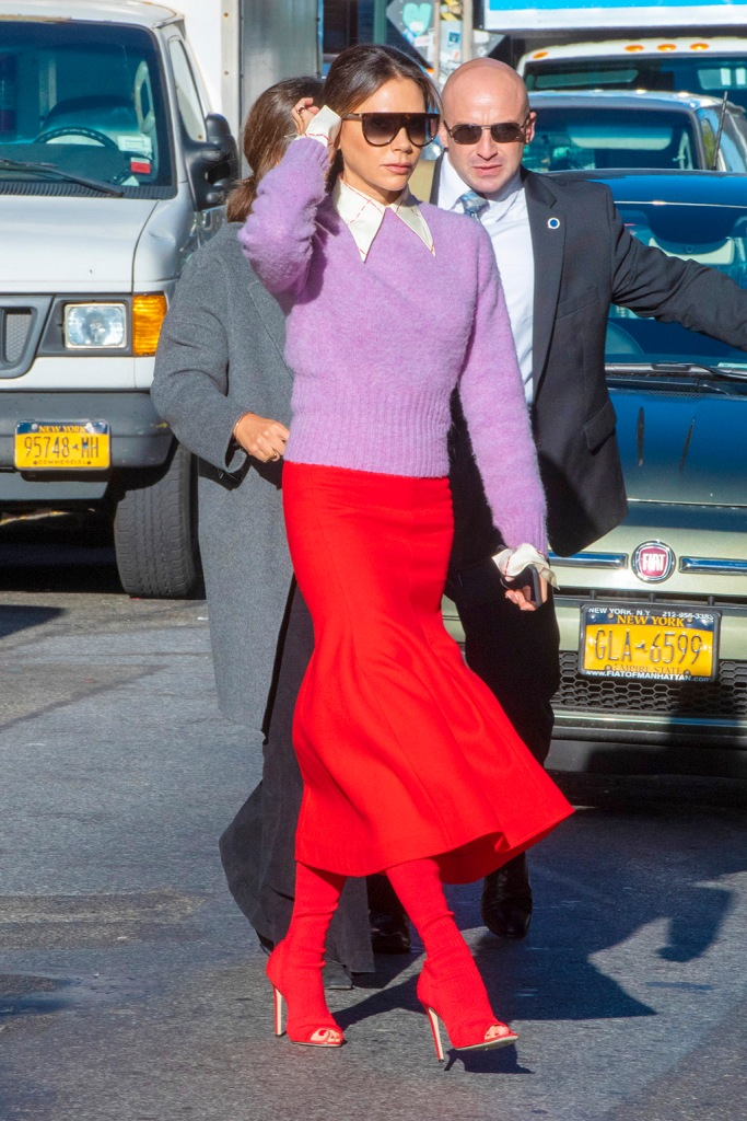 Victoria beckham, red midi skirt, purple sweater, collared shirt, updo, Celine sunglasses, shades, peep-toe boots, Victoria beckham fall 20119, celebrity style, British singer and fashion designer Victoria Beckham heading to business meetings in NYC.Pictured: Victoria BeckhamRef: SPL5122350 151019 NON-EXCLUSIVEPicture by: SplashNews.comSplash News and PicturesLos Angeles: 310-821-2666New York: 212-619-2666London: +44 (0)20 7644 7656Berlin: +49 175 3764 166photodesk@splashnews.comWorld Rights