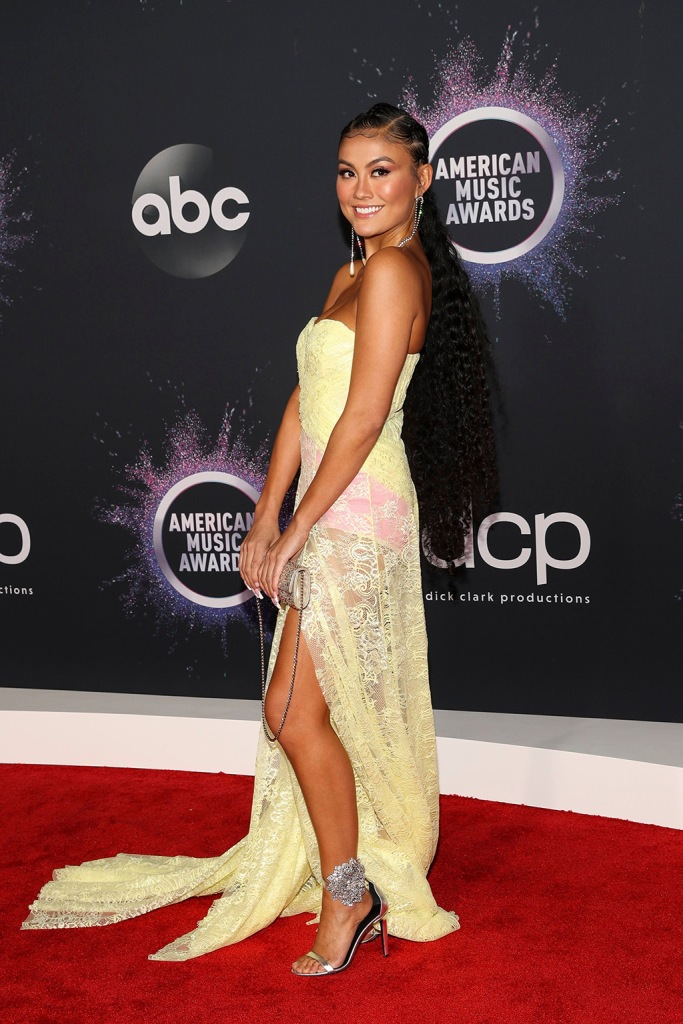 Agnez Mo, giuseppe zanotti, sandals, red carpet, lace dress, yellow dress, clutch, 47th Annual American Music Awards, Arrivals, Microsoft Theater, Los Angeles, USA - 24 Nov 2019