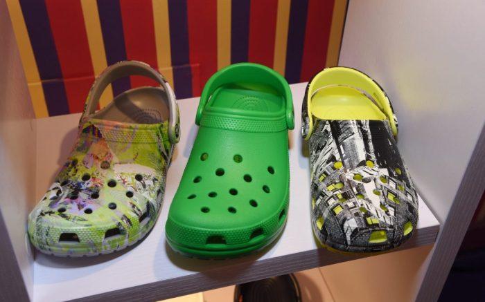 Three versions of the Crocs Classic Clogs.