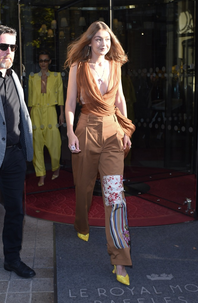 Gigi Hadid, Giorgia , yellow shoes, glitter pumps, pfw, paris fashion week, oscar de la renta, & Bella Hadid hold arms and laugh and smile as they are seen at 'The Americans In Paris' event at Paris fashion weekPictured: Gigi Hadid,Bella HadidRef: SPL5118976 280919 NON-EXCLUSIVEPicture by: New Media Images / SplashNews.comSplash News and PicturesLos Angeles: 310-821-2666New York: 212-619-2666London: +44 (0)20 7644 7656Berlin: +49 175 3764 166photodesk@splashnews.comWorld Rights