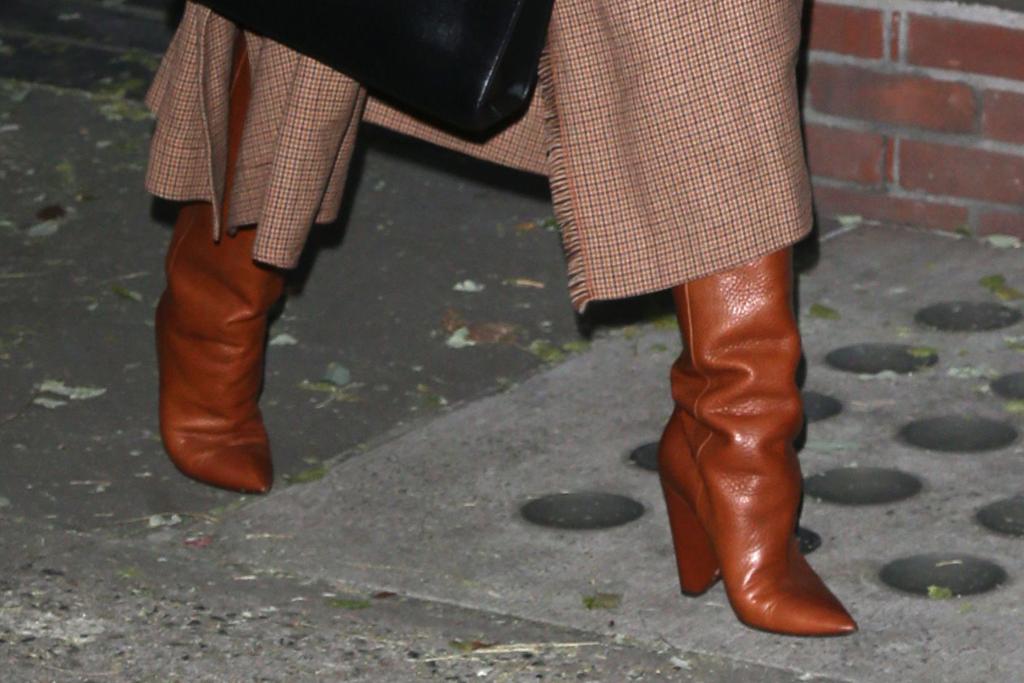 chrissy teigen, new york, brown jacket, boots, brown boots, saint laurent