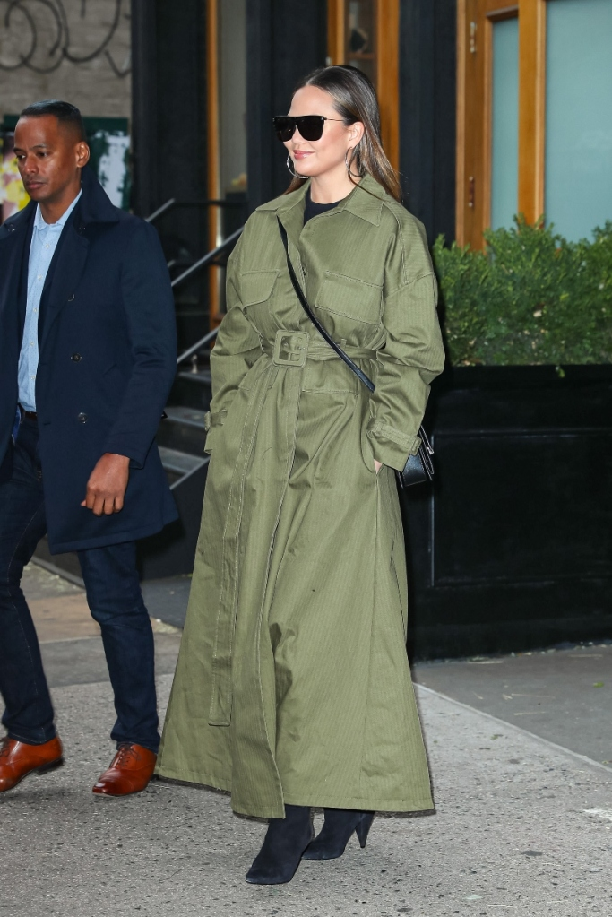 chrissy teigen, new york, green jacket, boots, black boots, saint laurent