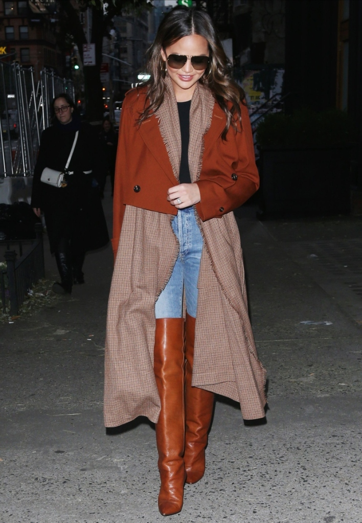 chrissy teigen, new york, brown jacket, boots, brown boots, saint laurent