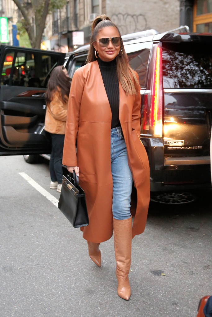 chrissy teigen, loewe, leather coat, black turtleneck, paris texas shoes, croc-print shoes, knee-high boots, hoop earrings, saint laurent purse, Model Chrissy Teigen leaves her apartment to see The Rockettes in New York CityPictured: Chrissy TeigenRef: SPL5131247 231119 NON-EXCLUSIVEPicture by: Christopher Peterson / SplashNews.comSplash News and PicturesLos Angeles: 310-821-2666New York: 212-619-2666London: +44 (0)20 7644 7656Berlin: +49 175 3764 166photodesk@splashnews.comWorld Rights