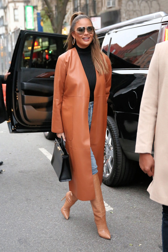 chrissy teigen, loewe, leather coat, black turtleneck, paris texas shoes, croc-print shoes, knee-high boots, hoop earrings, saint laurent purse, Model Chrissy Teigen leaves her apartment to see The Rockettes in New York CityPictured: Chrissy TeigenRef: SPL5131247 231119 NON-EXCLUSIVEPicture by: Christopher Peterson / SplashNews.comSplash News and PicturesLos Angeles: 310-821-2666New York: 212-619-2666London: +44 (0)20 7644 7656Berlin: +49 175 3764 166photodesk@splashnews.comWorld RightsModel Chrissy Teigen leaves her apartment to see The Rockettes in New York CityPictured: Chrissy TeigenRef: SPL5131247 231119 NON-EXCLUSIVEPicture by: Christopher Peterson / SplashNews.comSplash News and PicturesLos Angeles: 310-821-2666New York: 212-619-2666London: +44 (0)20 7644 7656Berlin: +49 175 3764 166photodesk@splashnews.comWorld Rights