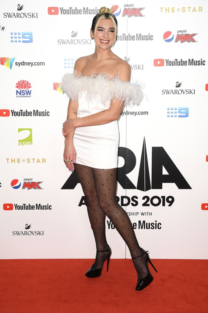 Dua Lipa, white dress, minidress, polka-dot tights, black pumps, ysl, saint laurent, legs, arrives at the 33rd Annual ARIA Music Awards at The Star in Sydney, Australia, 27 November 2019.33rd ARIA Music Awards, Sydney, Australia - 27 Nov 2019