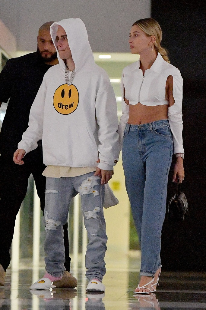 Justin Bieber, slippers, drew house sweatshirt, jeans, hailey baldwin, crop top, opening ceremony shirt, mom jeans, thong sandals, bottega veneta shoes, and Hailey Bieber go out to dinner at KOMODO in Miami,Florida.The newly married couple walked hand-in-hand for a date night in Miami,Florida.Pictured: Justin Bieber,Hailey BieberRef: SPL5131904 261119 NON-EXCLUSIVEPicture by: Robert O'Neil / SplashNews.comSplash News and PicturesLos Angeles: 310-821-2666New York: 212-619-2666London: +44 (0)20 7644 7656Berlin: +49 175 3764 166photodesk@splashnews.comWorld Rights