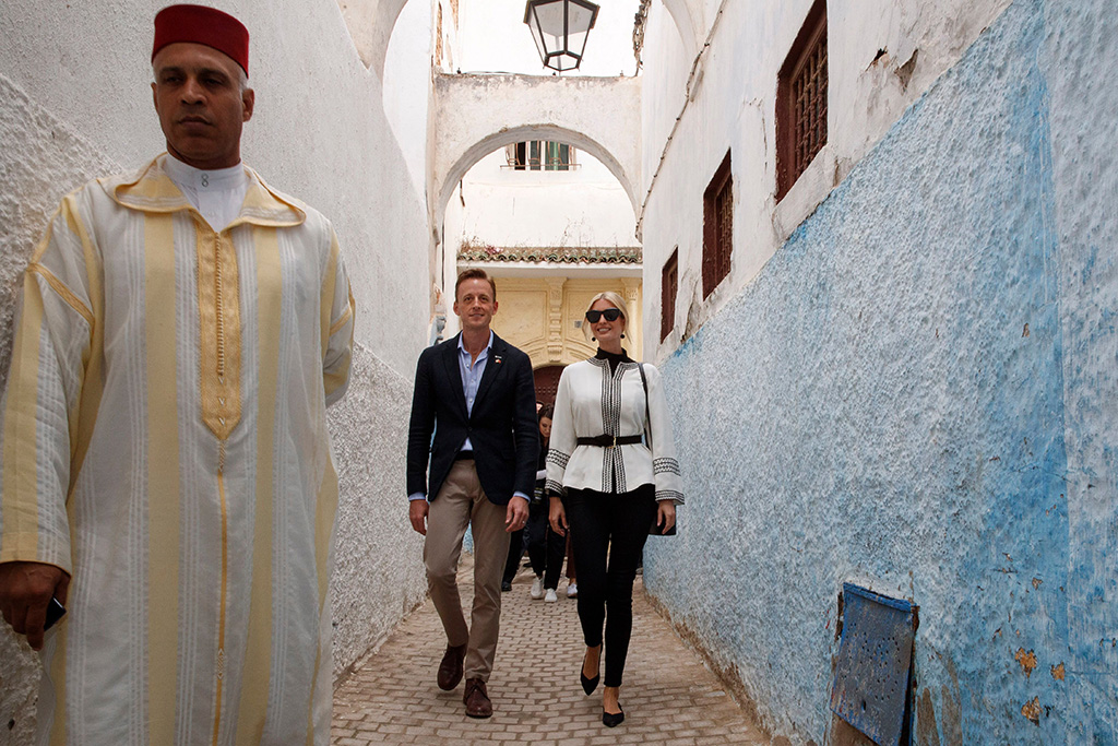 Ivanka Trump, black pants, white shirt, rothys flats, celebrity style, first daughter, Sean Cairncross. Ivanka Trump, right, the daughter and senior adviser to President Donald Trump, walks with Sean Cairncross, CEO of the Millennium Challenge Corporation, through a medina, in Rabat, Morocco, after attending a tea ceremony and roundtable eventUS Ivanka Trump, Sidi Kacem, Morocco - 07 Nov 2019