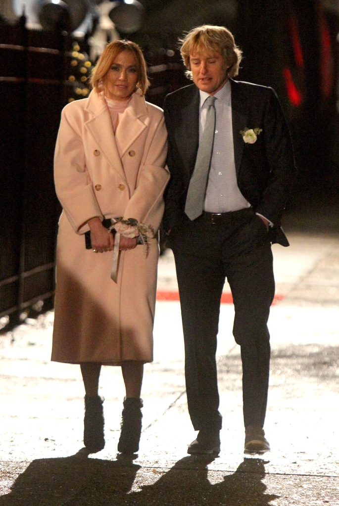 """Jennifer Lopez, max mara coat, pink coat, celebrity style, jimmy choo shoes, pumps, stilettos, j-lo, and Owen Wilson pictured filming a scene before wrapping production at the """"Marry Me"""" movie set in Brooklyn.Pictured: Jennifer Lopez and Owen WilsonRef: SPL5131301 241119 NON-EXCLUSIVEPicture by: Jose Perez / SplashNews.comSplash News and PicturesLos Angeles: 310-821-2666New York: 212-619-2666London: +44 (0)20 7644 7656Berlin: +49 175 3764 166photodesk@splashnews.comWorld Rights"""