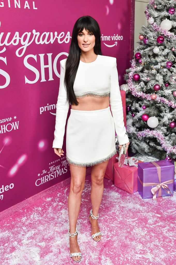 Kacey Musgraves, david koma, crop top, miniskirt, abs, stomach, legs, celebrity style, red carpet, brown hair, bangs, new hair, stella luna sandals, chain sandals, silver sandals, Amazon Prime Video's 'The Kacey Musgraves Christmas Show' launch party, Arrivals, Metrograph Theater, New York, USA - 19 Nov 2019Wearing David Koma