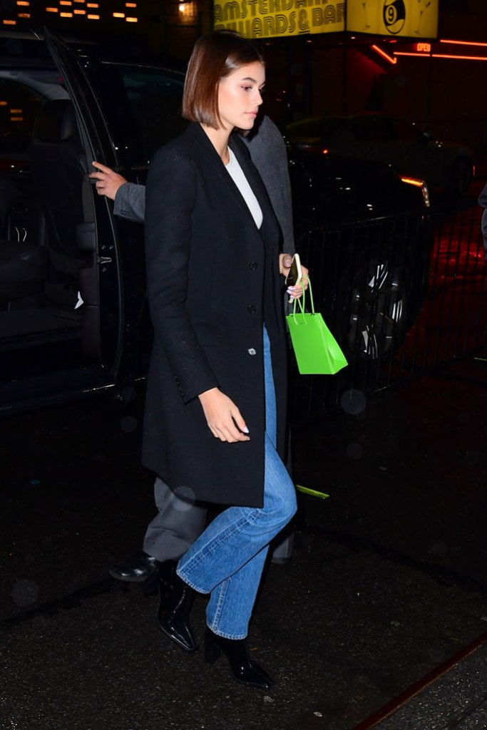 Kaia Gerber, celebrity style, street style, new york city, black jacket, green purse, jeans, black boots, square toes,