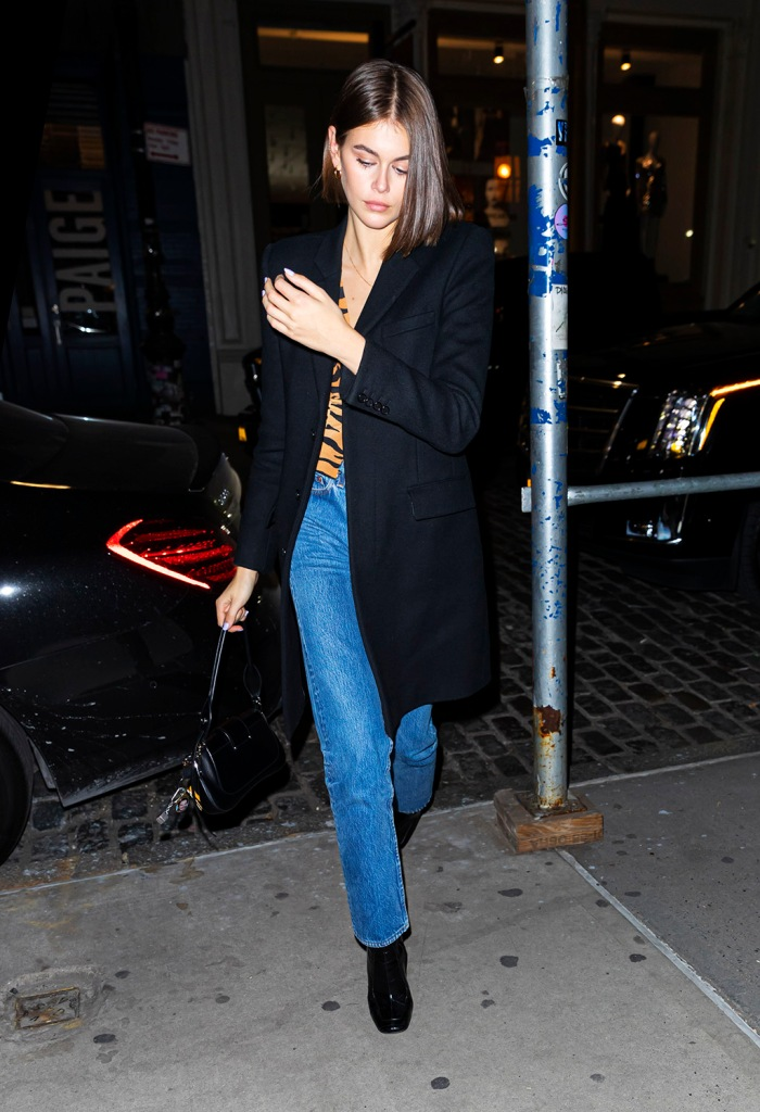 Kaia Gerber, black boots, celebrity style, square toes, straight leg jeans, celebrity style, nyc, black coat, crop top, tiger shirt, cindy crawford daughter, Pete Davidson and Kaia Gerber enters her apartment together at 3:30am on Pete's birthday after his SNL performance and afterparty in New YorkPictured: Pete Davidson and Kaia GerberRef: SPL5129778 171119 NON-EXCLUSIVEPicture by: Jackson Lee / SplashNews.comSplash News and PicturesLos Angeles: 310-821-2666New York: 212-619-2666London: +44 (0)20 7644 7656Berlin: +49 175 3764 166photodesk@splashnews.comWorld Rights, No Portugal Rights