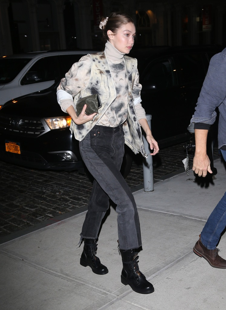 Kendall Jenner, jeans, tie-dye jacket, turtleneck, louis vuitton shoes, combat boots, celebrity style, scrunchie, clutch, Gigi Hadid and Joan Smalls at Carbone in New YorkPictured: Gigi HadidRef: SPL5130406 201119 NON-EXCLUSIVEPicture by: SplashNews.comSplash News and PicturesLos Angeles: 310-821-2666New York: 212-619-2666London: +44 (0)20 7644 7656Berlin: +49 175 3764 166photodesk@splashnews.comWorld Rights