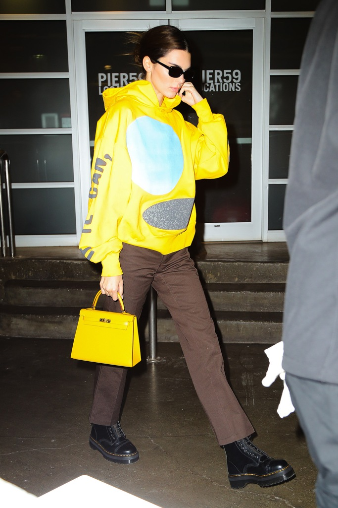 Kendall Jenner, celebrity style, kanye west x cactus plant flea market hoodie, street style, nyc, kanye west x cactus plant flea market, brown pants, dr martens boots, dr martens sinclair, combat boots, Kendall Jenner seen leaving a Photoshoot in New York CityPictured: Kendall JennerRef: SPL5130119 181119 NON-EXCLUSIVEPicture by: Felipe Ramales / SplashNews.comSplash News and PicturesLos Angeles: 310-821-2666New York: 212-619-2666London: +44 (0)20 7644 7656Berlin: +49 175 3764 166photodesk@splashnews.comWorld Rights
