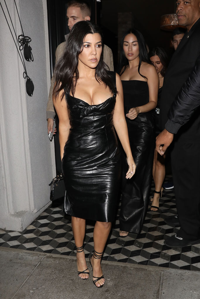Kourtney Kardashian, black dress, lbd, los angeles, celebrity style, shiny dress, leather dress, cleavage, low-cut dress, legs, strappy sandals, manolo blahnik shoes,