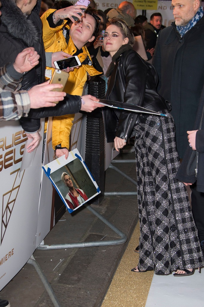 Kristen Stewart, thom browne dress, resort 2019, sandals, stilettos, toes, pedicure, fans, leather jacket, nike cortez, sneakers, poses for photographs with fans upon arrival at the UK premiere of 'Charlie's Angels', at a central London cinemaCharlie's Angels Premiere, London, United Kingdom - 20 Nov 2019