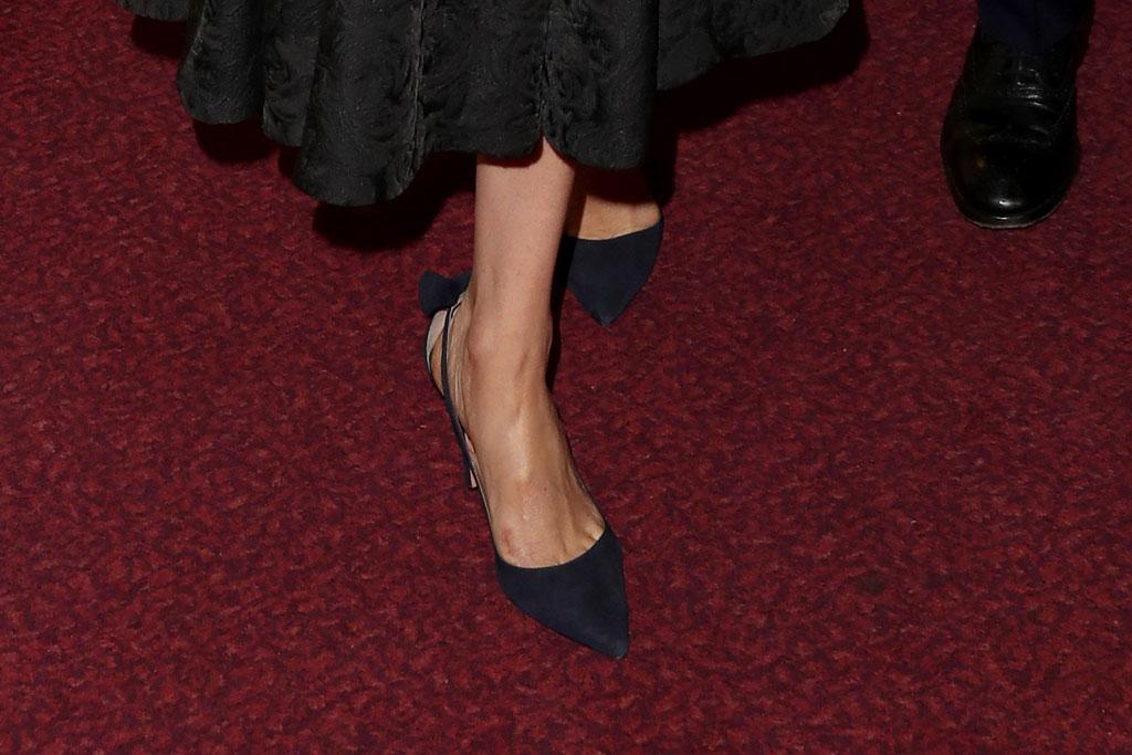 meghan markle, black dress, aquazzura shoes, black pumps, bow adorned heels, celebrity style, royal, Members of the Royal Family attend the Royal British Legion Festival of Remembrance at the Royal Albert Hall, London, UK, on the 9th November 2019. Picture by Chris Jackson/WPA-Pool. 09 Nov 2019 Pictured: Meghan Markle, Duchess of Sussex. Photo credit: MEGA TheMegaAgency.com +1 888 505 6342 (Mega Agency TagID: MEGA545473_005.jpg) [Photo via Mega Agency]., shoe detail