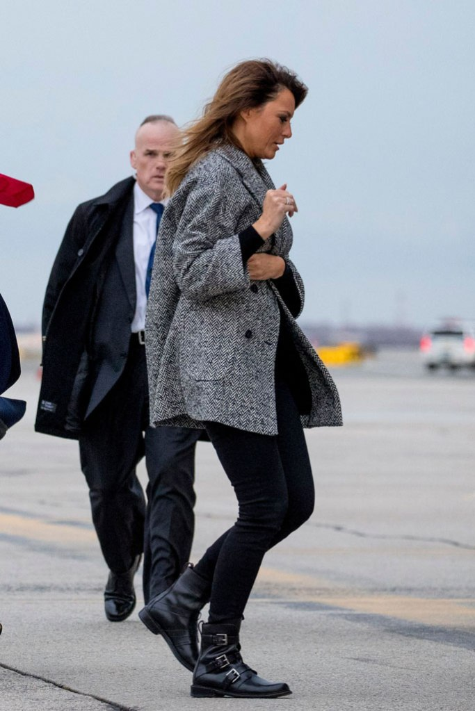 Melania Trump, black and white coat, red valentino coat, skinny jeans, black pants, combat boots, new york city, air force one, november 2019