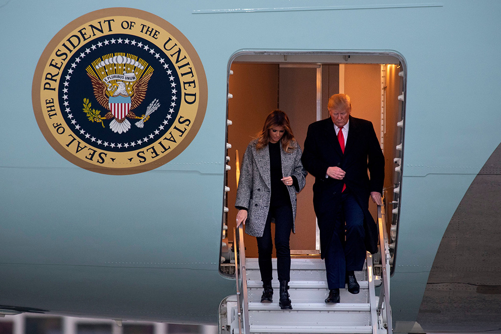 melania trump, red valentino coat, black pants, skinny jeans, combat boots, flotus, President Donald Trump and first lady Melania Trump depart Air Force One, at Andrews Air Force Base, Md. following a trip to New YorkTrump - 12 Nov 2019
